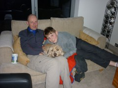 A young Thomas with Jonathan and Maggie the labradoodle