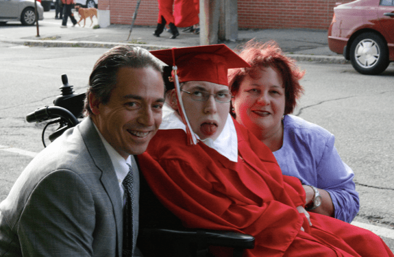 Michael and his wife with their son on his graduation day