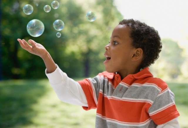 Image result for autistic child playing bubbles