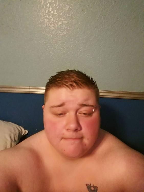 man with buzz cut not wearing shirt