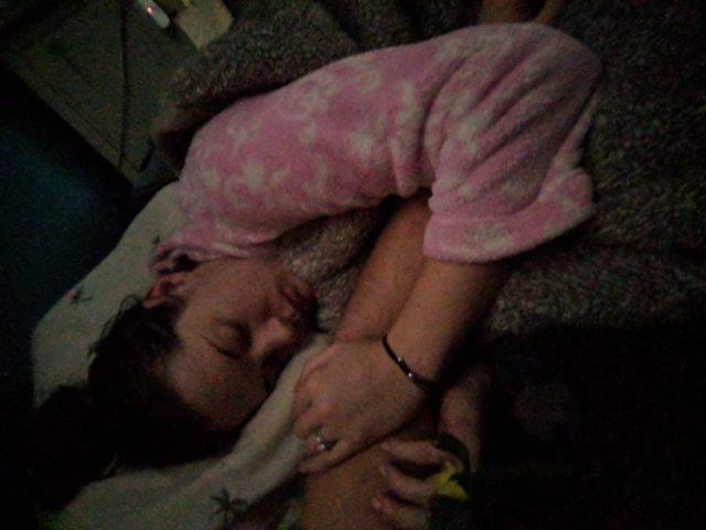 woman lying in bed sick