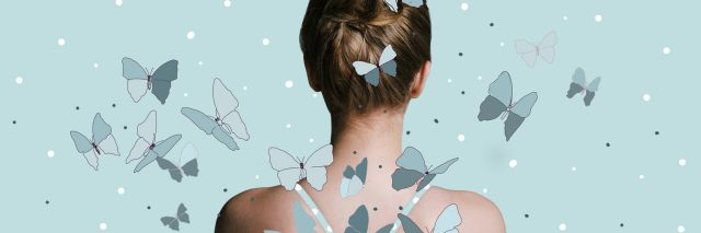 back view of a woman with her hair in a bun against a blue background with butterflies flying around