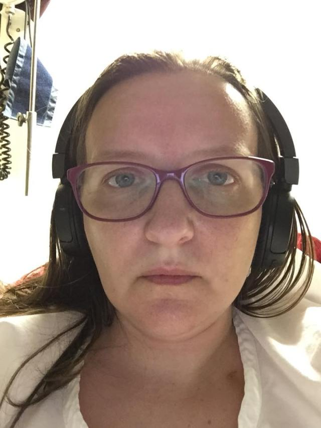 woman wearing glasses and headphones