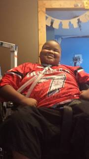Xzavier in his new jersey. He asked his mom if he looks like a football player in it.