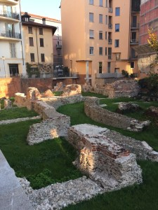The ruins of the Roman theatre nearby Corso Magenta.