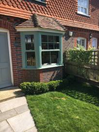 Sliding sash windows in Chartwell green