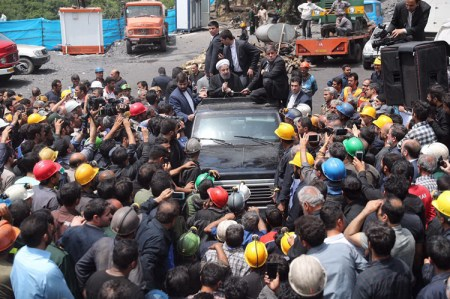 Iran's President Hassan Rouhani, in car, surrounded by coal miners, Azadshahr, Iran, May 2017; 26 miners had been killed in May 3 mine collapse. Workers in Iran are taking advantage of factional divisions in ruling class to open more political space to speak and act.