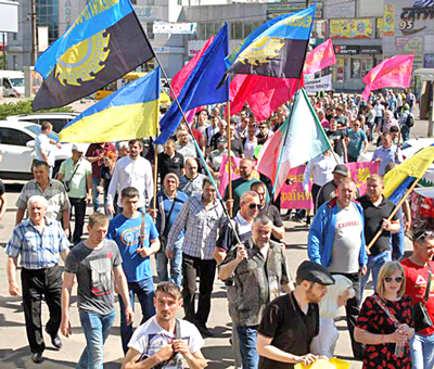 Workers march on May Day in Kryvyi Rih, a major industrial center in Ukraine, in fight for pay raise, safe working conditions and new union contract at ArcelorMittal steel plant there.