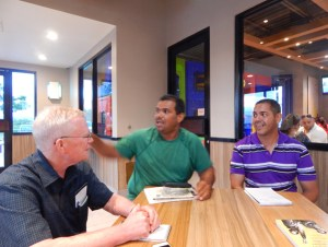 Above, fisherman Luis Velázquez, center, describes what fishermen face from government neglect after Hurricane Maria destroyed their dock to Lenis Rodríguez, right, leader of Yabucoa Support Group, and John Studer, editor of the Militant.
