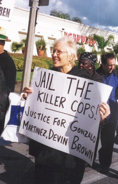 Wendy Lyons joins 2006 protest against killings, brutality by cops in Los Angeles.