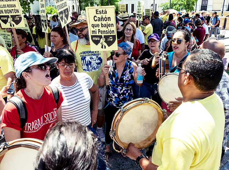 Teachers, students and parents rally in San Juan, Puerto Rico, Aug. 15 during protest against closings of public schools, overcrowding in those still open and poor conditions teachers face.