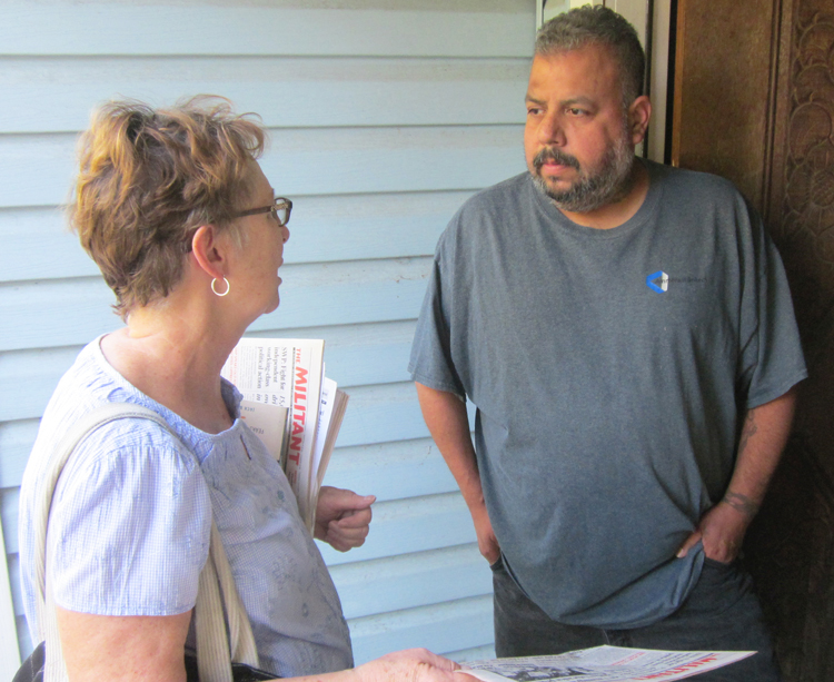 """Alyson Kennedy, left, SWP candidate for U.S. Senate from Texas, met Uber driver Jesus Alvarado on his doorstep in Grand Prairie, Aug. 20. He said he almost became homeless after losing his job in 2008. """"Working people need to unify to fight bosses' attacks,"""" Kennedy said."""