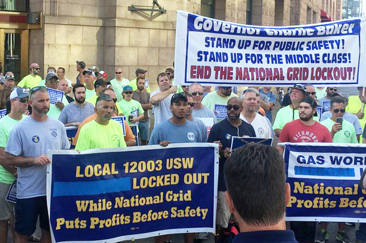 Unionists locked out by National Grid power company at Aug. 29 protest, above, offered to help after explosions at homes served by nonunion Columbia Gas. They were turned down.