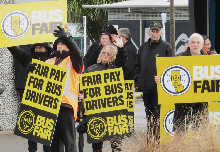 Bus drivers, members of FIRST Union, carried out one-day strike against Go Bus. They picketed transport center in Hamilton, New Zealand, Aug. 14, demanding equal pay for same work.