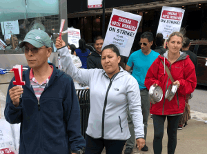 """Hotel workers on strike in Chicago picket Hyatt Regency Sept. 7. """"We need health insurance no matter what our hours were the previous months,"""" waitress Rafaela Sandoval told the Militant."""