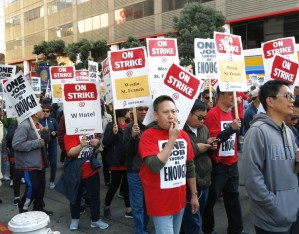 Some 1,000 members of UNITE HERE on strike against Marriott hotels and supporters march in San Francisco Oct. 20 demanding guaranteed hours, affordable health care and higher pay.