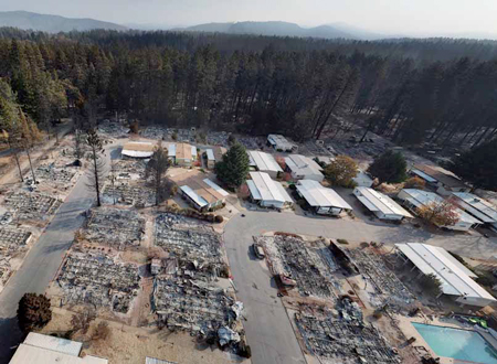 Drone photo of damage near Paradise, California, where Camp Fire ravaged region. It broke out under PG&E high voltage lines shortly after company reported wire problems there.