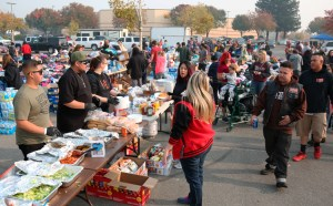 Impalas Car Club members serve meal to fire survivors in Walmart lot, Chico, California, Nov. 17. In face of government neglect, working-class solidarity key to get food, clothes, supplies.