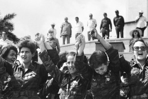 "Members of Cuban women's antiaircraft artillery unit, May 1989, after return from Angola following defeat of South African invasion. ""Cuban volunteers on internationalist missions,"" said Zayas, ""are learning about capitalism, about the exploitation of man by man."""