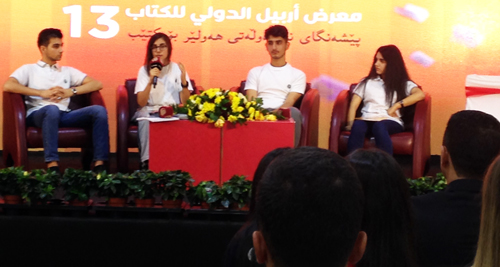 """Rose, 15, who bought Is Biology Woman's Destiny? at booth, speaks at book fair panel on """"Humanity and Its Link to Peace."""" """"Religions separate us,"""" she said. """"We should unite as one. ... How many more wars must we suffer from?"""""""