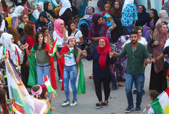 Kurds in Qamishli, Syria, celebrate pro-independence vote in referendum in Kurdish region of Iraq Sept. 26, 2017. After vote, Iraqi army and Iranian-backed militias attacked and occupied Kirkuk, wrested 40 percent of region from Kurdistan Regional Government, closed international air travel, imposed economic sanctions.