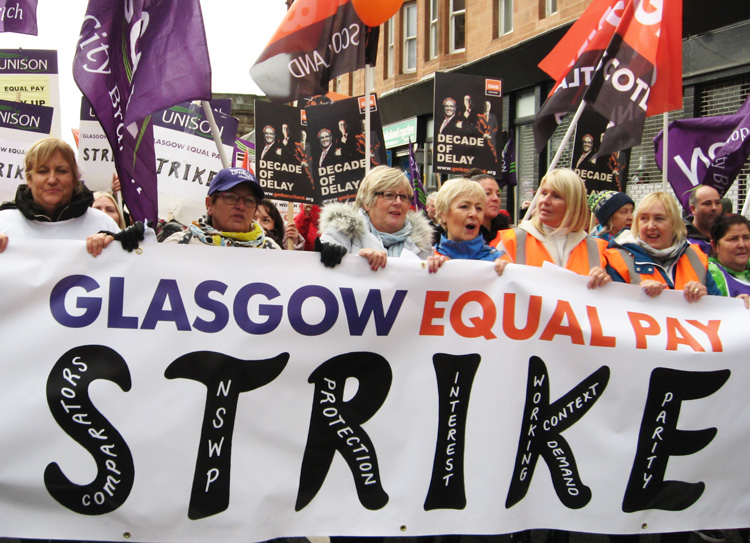 During two-day strike for equal pay, local council workers in Glasgow, Scotland, mostly women, win support of fellow trade unionists Oct. 23. Male co-workers wouldn't cross picket lines.