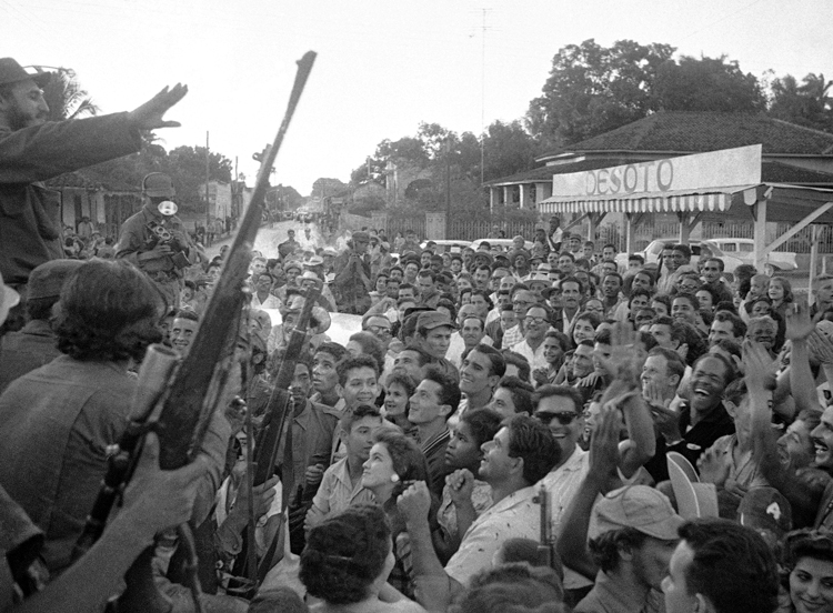 """People in Colón, Cuba, greet Fidel Castro, above left, Jan. 7, 1959, as """"Liberty Caravan"""" went to Havana. Castro led Rebel Army, Cuban workers and farmers to victory, then led millions to carry out, defend socialist revolution."""