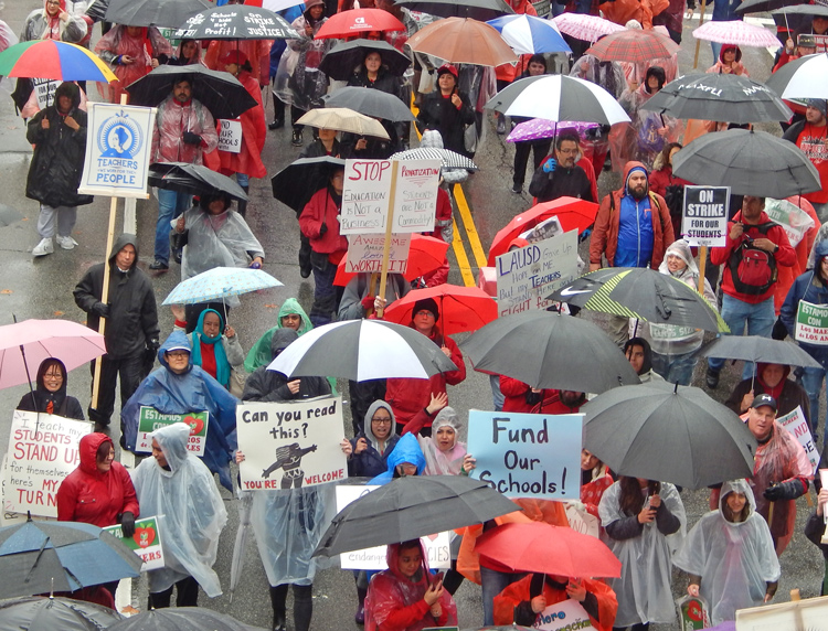 More than 30,000 members of teachers union and supporters march in Los Angeles Jan. 14, as strike begins demanding smaller classes, full-time nurses and librarians, and pay increase.