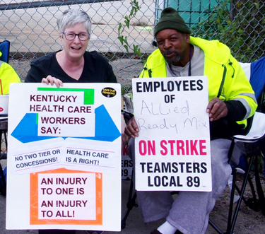 Amy Husk, SWP candidate for Kentucky governor, helps build solidarity with workers under attack. Above, she joined workers on strike on Allied Ready Mix picket in Louisville Oct. 19