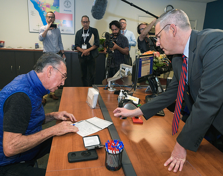 Vietnam veteran Alan Rhyelle registers to vote Jan. 8 in Sarasota, Florida, one of more than a million ex-prisoners whose right to vote was restored by passage of Amendment 4 last year. He had been convicted of a felony in 2008 for growing marijuana for his personal use.