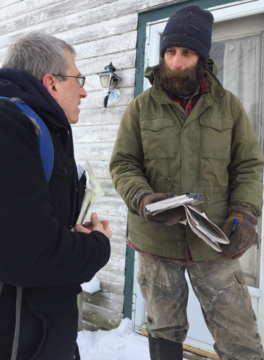 Peter Hula, right, in Richfield Springs, talks with SWP candidate Seth Galinsky about catastrophe dairy farmers face after years of milk prices below cost of production.