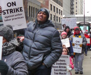 Chicago Teachers Union members and supporters picket Chicago International Charter School headquarters Feb. 5, first day of strike at four charter schools over class size, pay, conditions.