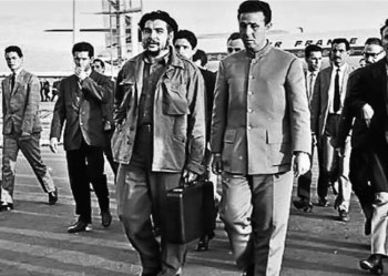 Ernesto Che Guevara with Algerian President Ahmed Ben Bella, right, at Algiers airport, April 1964. Ben Bella government collaborated with Guevara and other Cuban leaders to aid national liberation struggles in Africa.