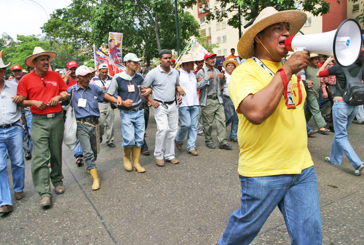 March in 2005 in Caracas, Venezuela, to protest killings of peasant leaders and demand land and credit. Land law proclaimed by Hugo Chávez left big landowners largely untouched.