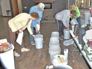 """Volunteers from McCook, Nebraska, organize """"flood buckets"""" of supplies to take to areas battered by flooding. Government officials had left those hard hit to fend for themselves."""