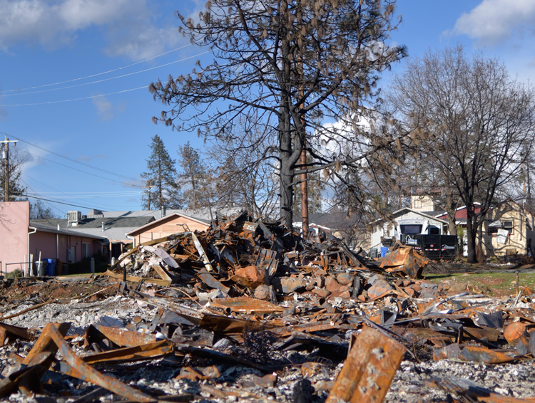 Rubble of Paradise building burned by wildfire four months ago sits untouched. Residents are still denied right to return to any properties with burn damage.