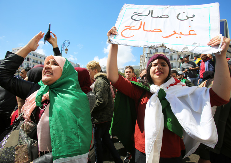 """Protesters in Algiers April 9 demand removal of entire government after Algerian President Abdelaziz Bouteflika was replaced by Abdelkader Bensalah. Placard reads, """"Bensalah, not fit."""""""