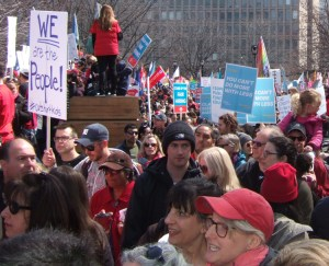 Teachers rally outside Ontario Legislative Assembly to protest education cuts by provincial government that eliminate 3,475 teaching jobs and require students to take more courses online.