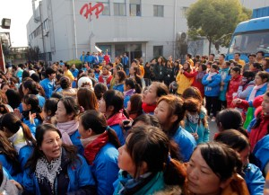 Workers block Hi-P company gates in Shanghai, 2011, after bosses announced layoffs. Rapid capitalist growth in China has created big industrial working class with great political potential.