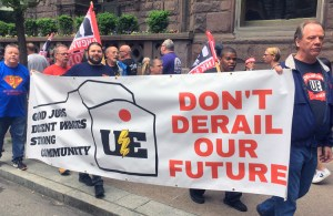 Workers from Wabtec locomotive plant in Erie, Pennsylvania, and supporters march outside company shareholders meeting in Pittsburgh May 17, against bosses' push for two-tier wages.