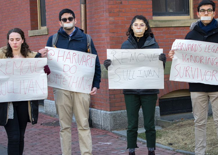 Students protest Feb. 11 for removal of African American Harvard law professor Ronald Sullivan as dean of Winthrop House. He was targeted for providing legal counsel to movie producer Harvey Weinstein. Inset, graffiti on college door.