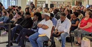 Militant   is appealing Florida prison ban on two issues of paper, including issue at left with article on tour of Albert Woodfox, who spent nearly 44 years in solitary confinement. Above, New Orleans Public Library meeting to hear Woodfox, March 20.