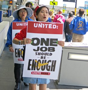 Airline catering workers at LSG Sky Chefs and Gate Gourmet mount informational picket demanding wage increase, better health coverage at San Francisco International Airport June 21.