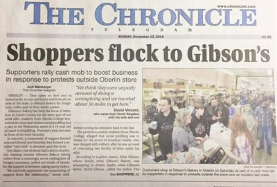 Local paper reports on people traveling from miles around to show support for Gibson's in face of attacks.