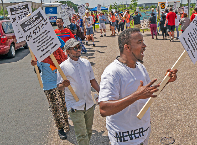 "Workers picket on ""Prime Day"" outside Shakopee, Minnesota, Amazon warehouse July 15."