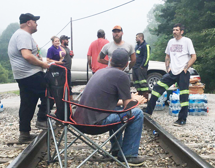 Coal miners and supporters block rail tracks at mine near Cumberland, Kentucky, to prevent Blackjewel Coal from shipping coal until company pays miners wages they are owed.