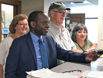 """Malcolm Jarrett, center, Socialist Workers Party candidate for Pittsburgh City Council, filed to get on ballot July 30, with supporters. """"We need to build a movement independent of the two capitalist parties, that fights to advance the working class to take power,"""" Jarrett says."""
