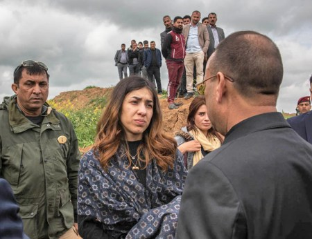 Nadia Murad, center, who escaped from Islamic State captivity, in discussion at event marking opening of first mass grave of Yazidis in Kocho. Hundreds of thousands of Yazidis remain displaced.