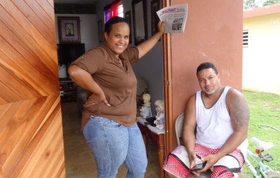 """Top, unrepaired home in Yabucoa two years after Hurricane Maria. """"What did government do with millions in aid?"""" said fisherman Julio Morales. Below, Karelys Velázquez and neighbor Nelson Martínez in Punta Santiago discuss common challenges facing workers in U.S. and Puerto Rico with SWP delegation."""