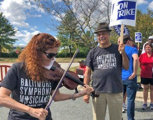 Baltimore Symphony musicians, who were locked out for over three months, joined United Auto Workers strike picket line at GM's transmission plant in White Marsh, Maryland, Sept. 18.